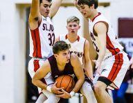 Same faces, new St. Johns boys basketball team