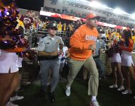 Dabo Swinney is wearing an insanely orange sportscoat on Signing Day