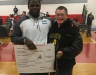 N.J. wrestler presents his gold medal to opponent with Down Syndrome