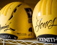 Players have their names hand-painted on back of Army Bowl helmets