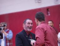 Arlington coach Fred Perry wrestles with retirement