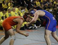 Prep team wrestling: Catholic Central continues cruise to state semis