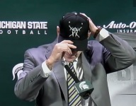 VIDEO: Michigan State coach Mark Dantonio donned hat from high school of each new signee