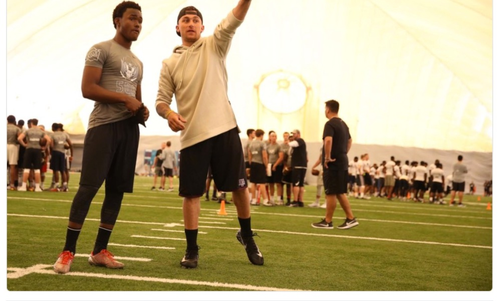 Johnny Manziel was coaching QB contenders at an Elite 11 camp in Miami (Photo: Twitter screen shot)
