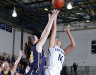 Junior's late basket lifts East Lansing past DeWitt for district title