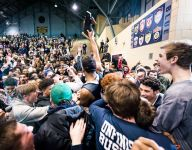 East Lansing fends off Everett for district title