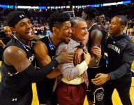 Heat forward Udonis Haslem salutes his high school coach, South Carolina's Frank Martin