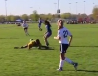 VIDEO: Watch world's most athletic youth soccer ref drop into impromptu splits to avoid pass