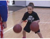 VIDEO: Minnesota's 7-year-old dribbling phenom gets surprise visit from a Globetrotter