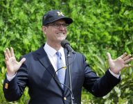 In-home visit with Jim Harbaugh features Christmas Caroling -- Michigan style