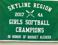 Ariz. softball players honor equipment manager's ailing wife on championship banner