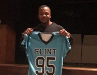 Flint's (Mich.) two remaining high schools to combine into one football team; ex-NFL player to coach
