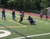 VIDEO: Elementary school flag football star bamboozles defense on TD run