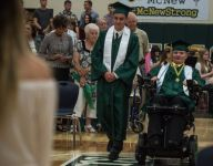 Paralyzed football player returns for graduation: 'He's an inspiration to everybody'