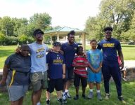 Three Michigan football players talk life, play flag football with youth team