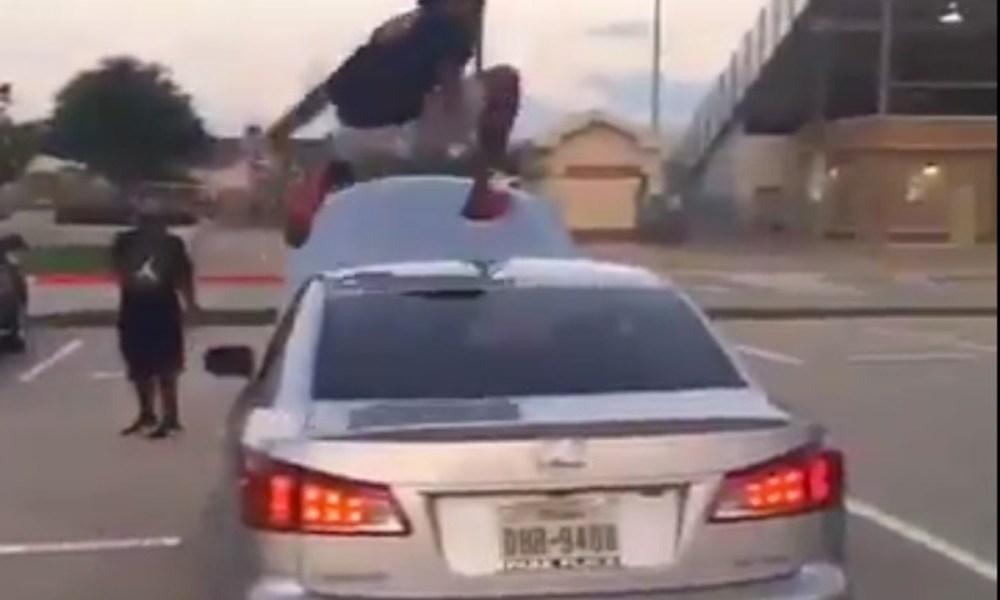 Marcel Brooks of Flower Mound Marcus leapt over a Lexus sedan (Photo: Twitter screen shot)