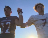 Wash. football teams lock arms as show of unity during national anthem