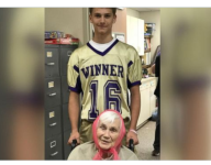 Football players in South Dakota wheel elderly residents out to enjoy homecoming parade