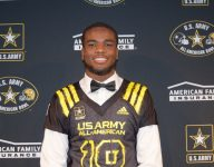 Tyreke Johnson takes a break from recruitment to receive U.S. Army All-American jersey