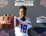 Oregon LB commit Adrian Jackson receives Under Armour All-American jersey during halftime ceremony