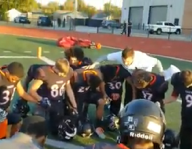 Okla. district investigates complaint that football coach leads team in Christian prayer before games