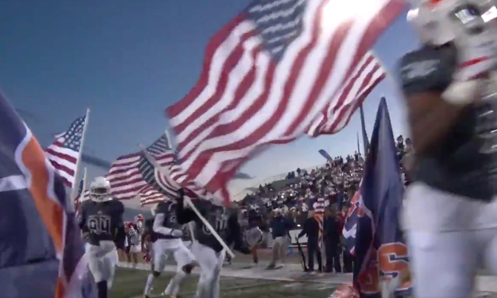 Sachse ran on to the field in Texas with each player carrying an American flag (Photo: @tedmadden/Twitter)