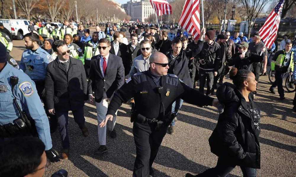Former Holy Cross junior varsity field hockey coach Gregory Conte is pictured in the red tie at a white supremacy rally in Washington, D.C. (Photo: Getty Images)