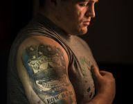 Son of slain police officer carries memory of father on, off wrestling mat