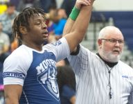 After surviving serious illness, Louisville wrestler becomes school's first state champ