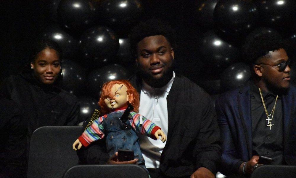 Nesta Silvera and his Chucky doll (Photo: @DBWilson2/Twitter screen shot)