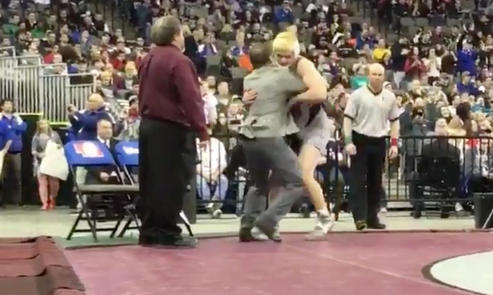 Matthew Montgomery is pinned by his Norfolk coach after a state title win (Photo: @MikeSautterOWH/Twitter screen shot)