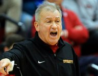 Massachusetts coach with 300 football victories wins No. 500 on the basketball court