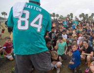 Dolphins and Stoneman Douglas football program combine to host youth football clinic