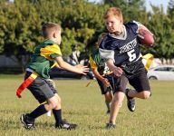 How old should kids be before they play tackle football? This Iowa legend says 14