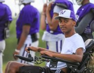 Paralyzed football player returns to field as volunteer coach