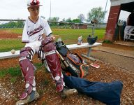 Despite national attention, one-armed catcher remains humble