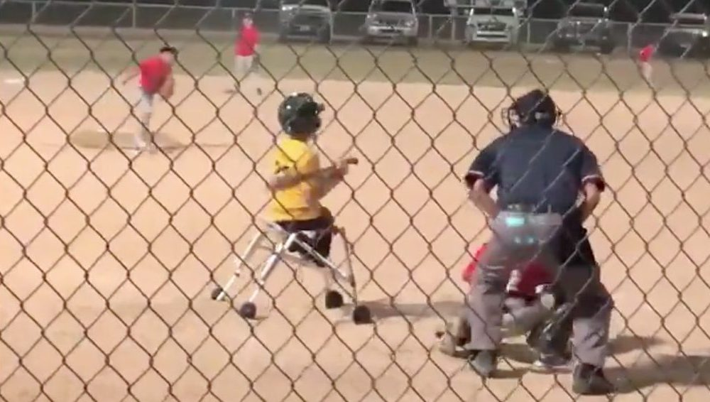 A youth baseball player with a walker both ran out a single and made a great play on the mound (Photo: @HCATovertime/Twitter screen shot)