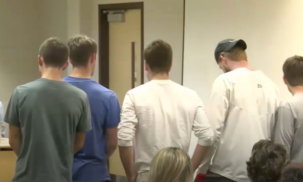Holt lacrosse players protest their coach at a school board meeting (Photo: WILX video screen shot)