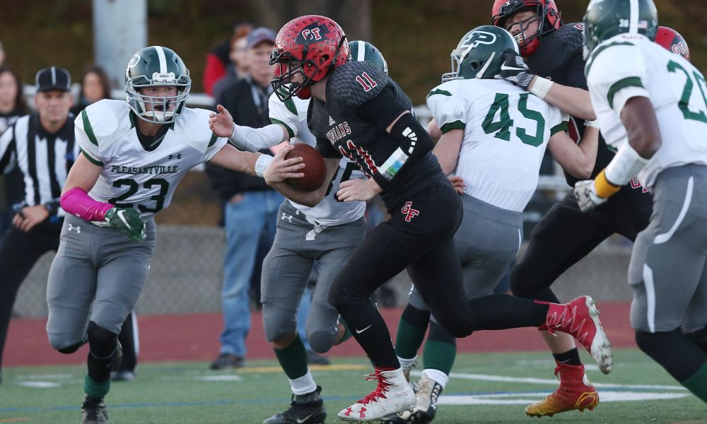 Pleasantville will play defending state champ Glens Falls at 3 p.m. Nov. 18 at Middletown High School in the Class B state semifinals. Glens Falls and quarterback Joe Girard III (11) won last year's semifinal over Pleasantville 49-14. (Photo: Frank Becerra Jr./The Journal News)