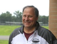 After cancer fight, New York football coach returns to sideline