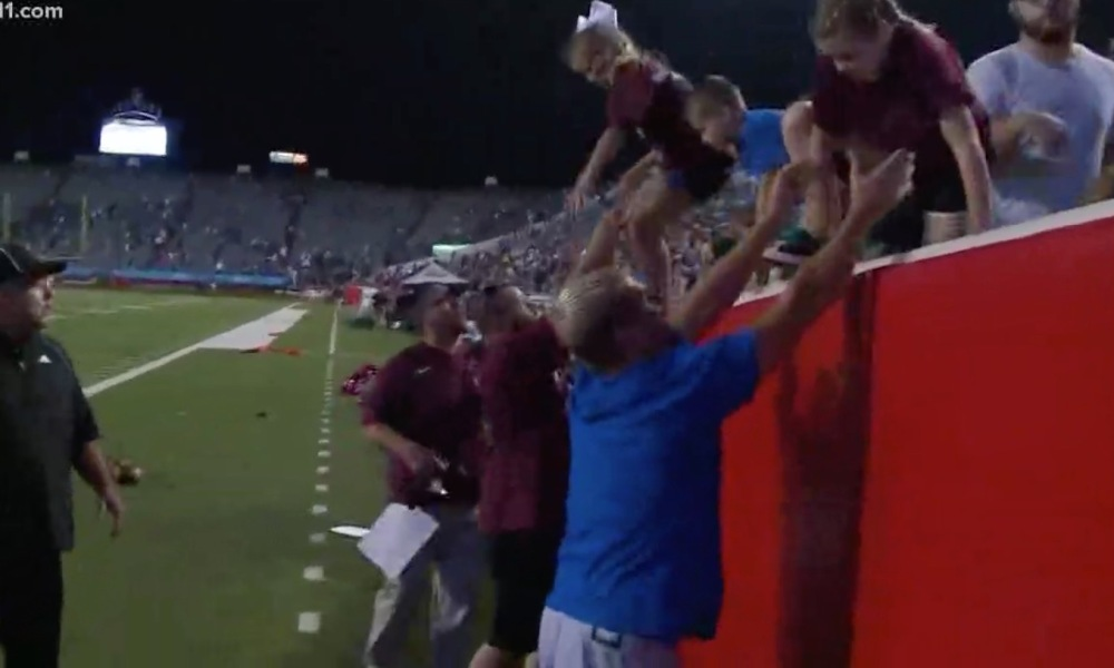 Fans at the annual Salt Bowl game flee during a panic (Photo: KTHV)