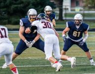 With two players committing to Wisconsin in less than a week, this suburban Milwaukee football program is producing plenty of talent