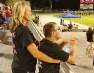 South Carolina HS player's brother with cerebral palsy stands during moment of silence for fallen officer