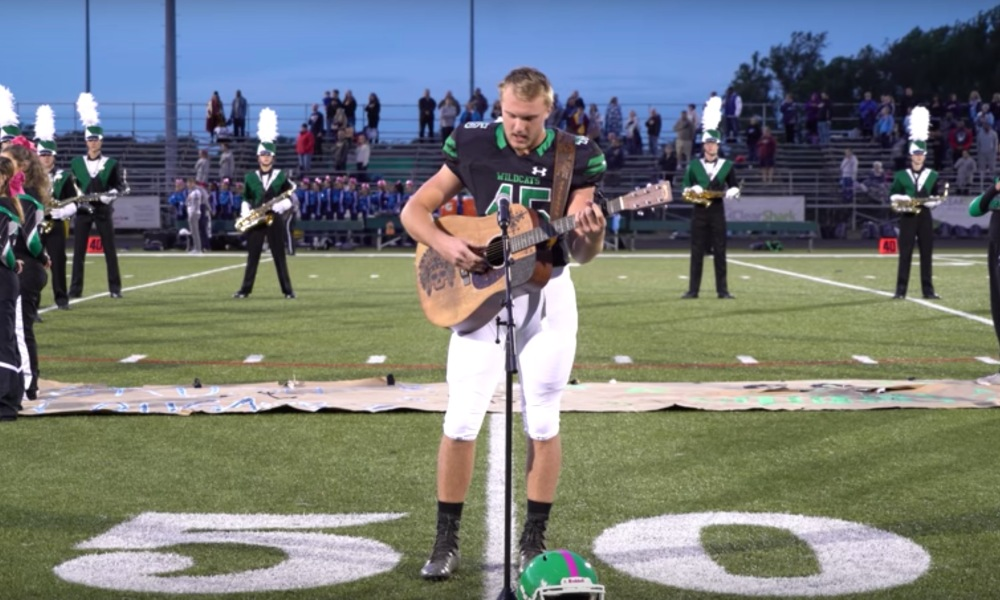 Jackson Dean Nicholson performs the national anthem before an Arundel football game (Photo: YouTube/JacksonDean)