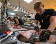Florida high school students farm, fillet, sell tilapia at homecoming football game
