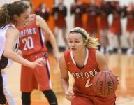Family matters: Whitlee Layne joins her father in 3,000 point club