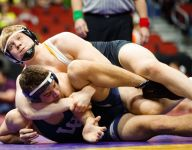 At this Iowa high school, wrestlers are taught their history so they can make more of it