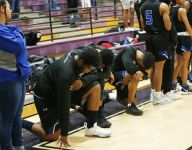 High school basketball players in Arizona kneel during national anthem