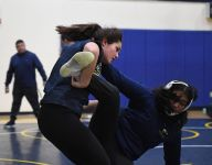 Female wrestler Melanie Martinez follows path of father, brothers, Olympian uncle