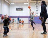 Spending Saturdays coaching children a slam dunk for Daniel High basketball teams